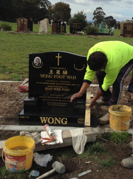 Stone mason erecting lawn headstone at Lilydale
